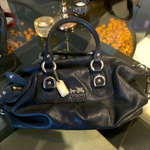 Genuine Coach handbag in black leather.